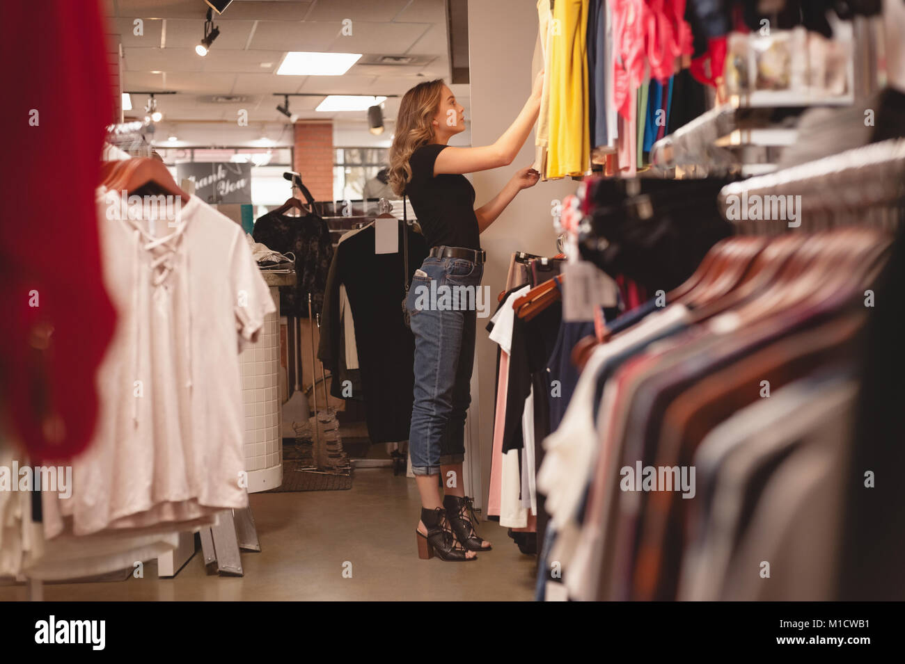 Beautiful woman shopping for clothes - Stock Image