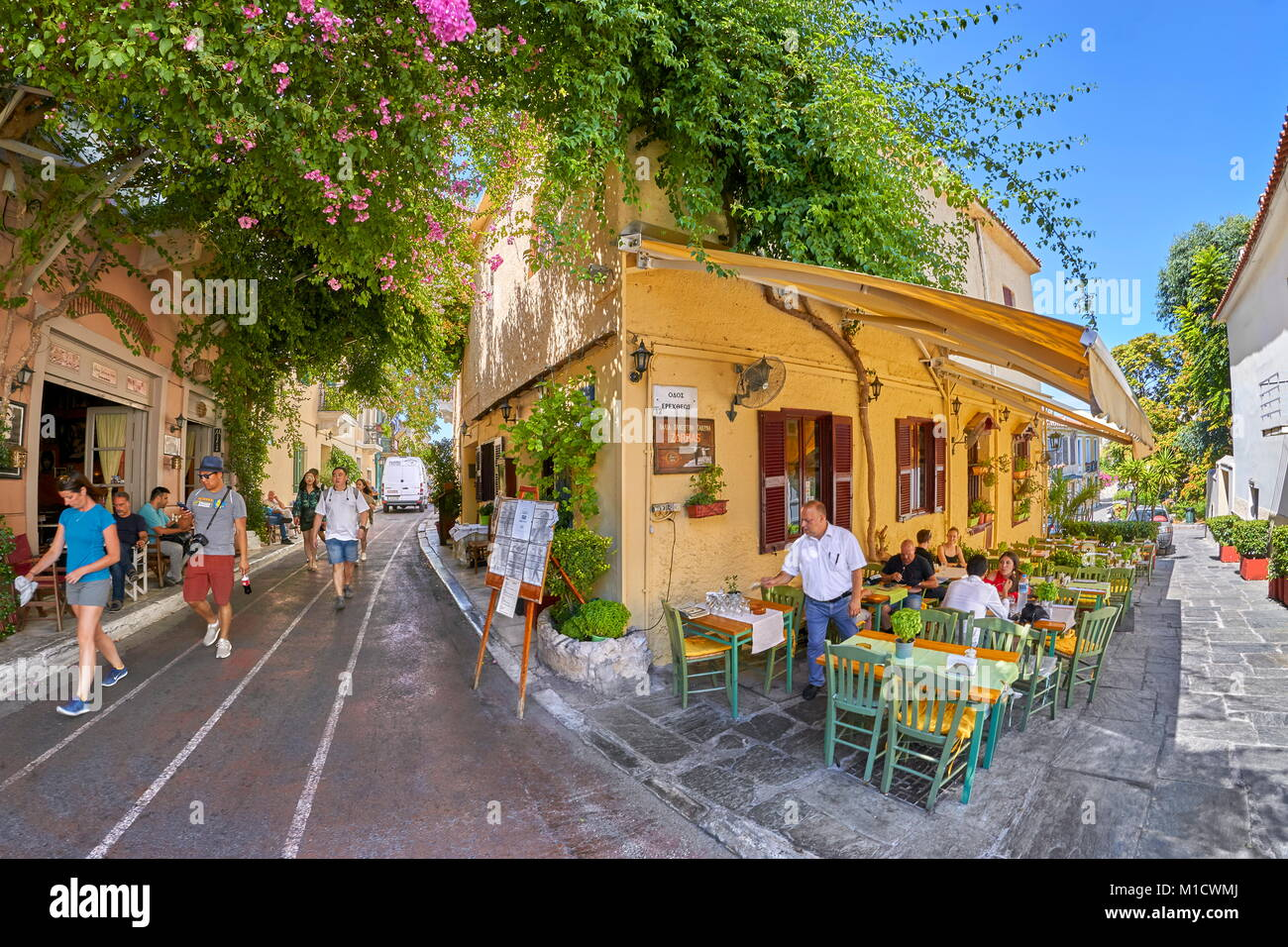 Traditional greek taverna, Plaka district, Athens, Greece - Stock Image