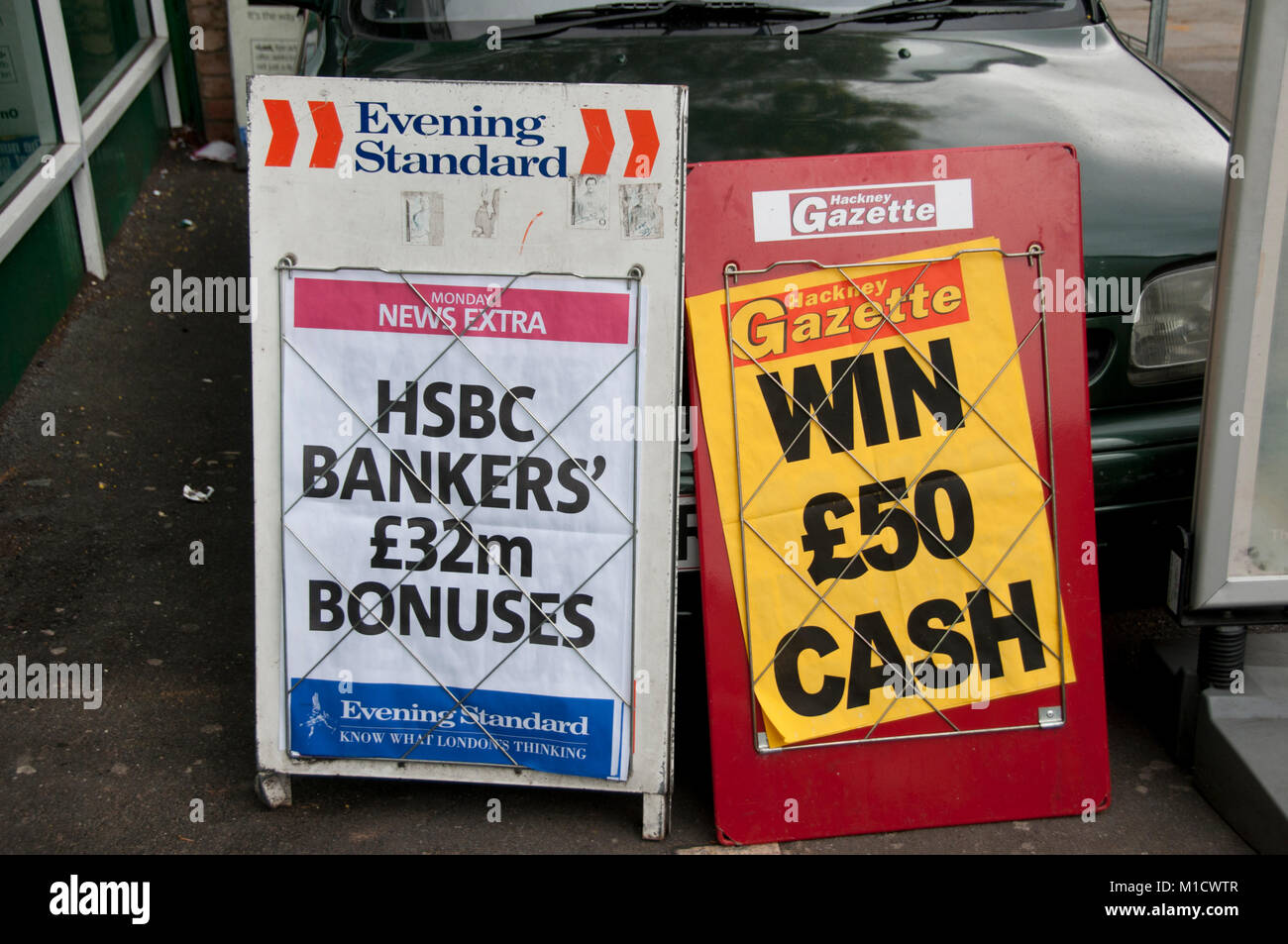 Inequality. An Evening Standard headline is HSBC Bankers £32million bonuses, whilst local paper Hackney Gazette - Stock Image