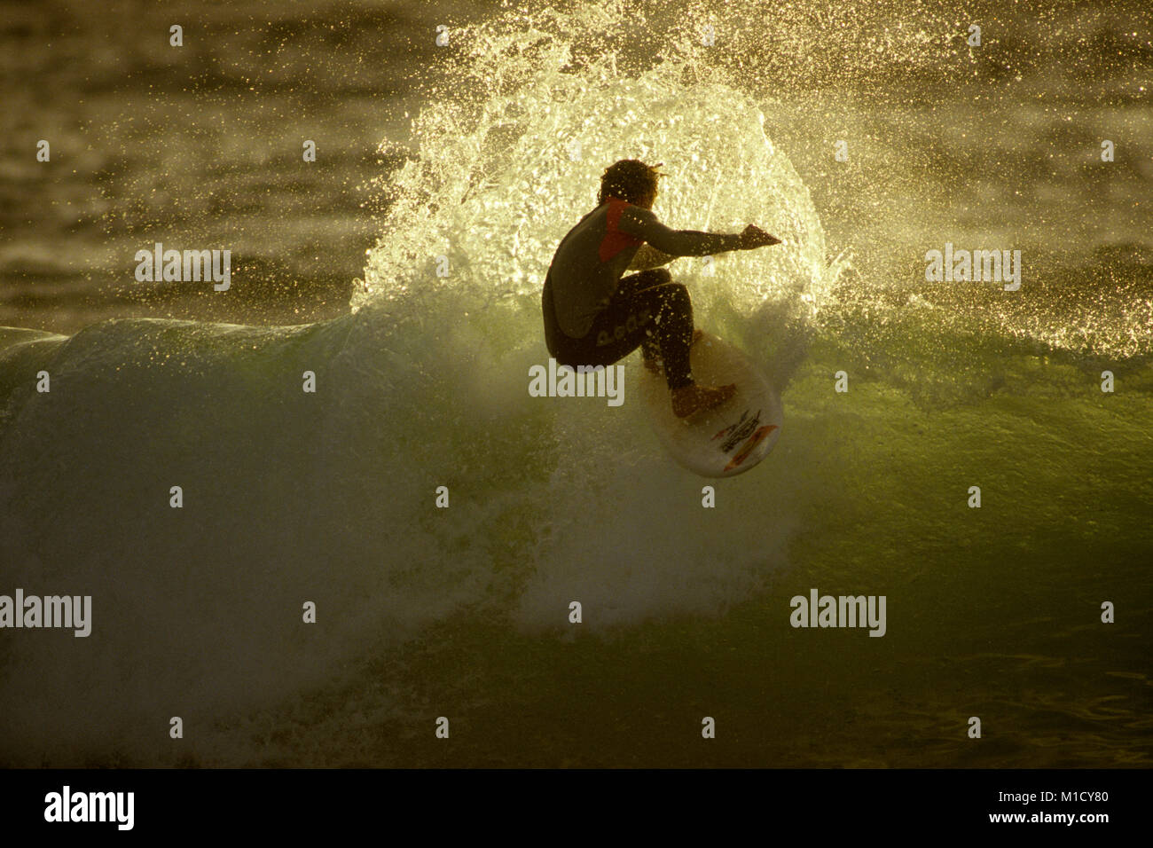 Mark Ochillupo performs his trademark off the lip manoeuvre at Fistral beach, Newquay, Cornwall, UK - Stock Image