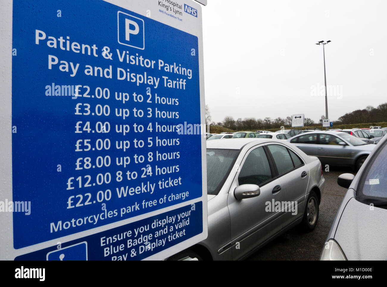 Information sign for car parking charges in the car park at Queen Elizabeth Hospital, King's Lynn, Norfolk, - Stock Image