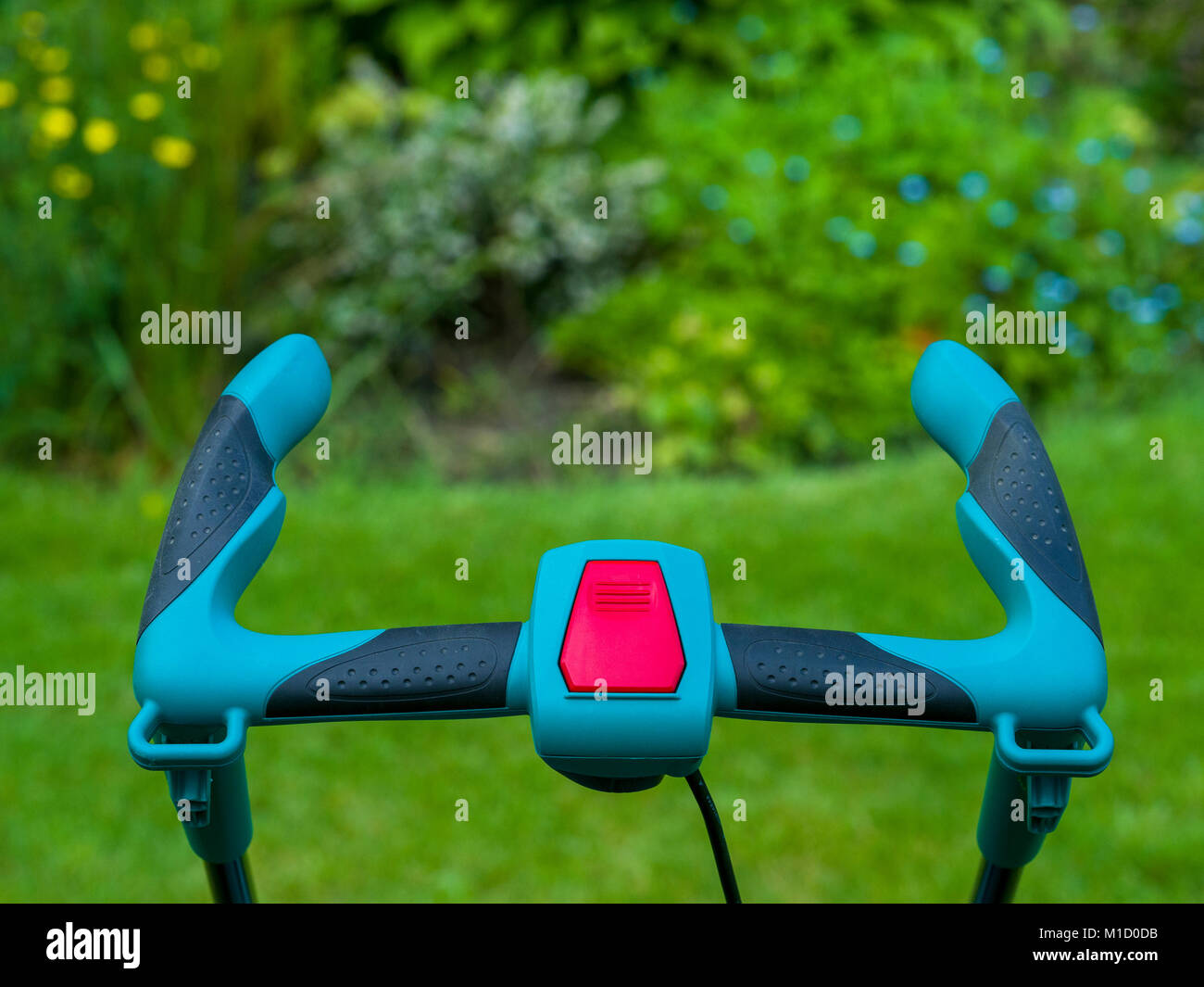 Ergonomic handlebars of cordless lawnmower - Stock Image