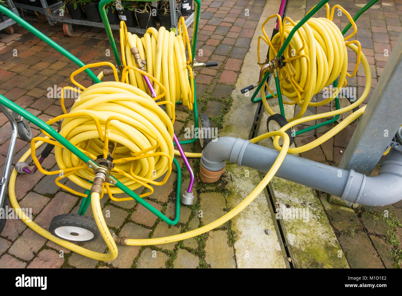 Three Market Garden Hose Reels With Yellow Kink Resisting Hose On Portable  Reels And Having Spray