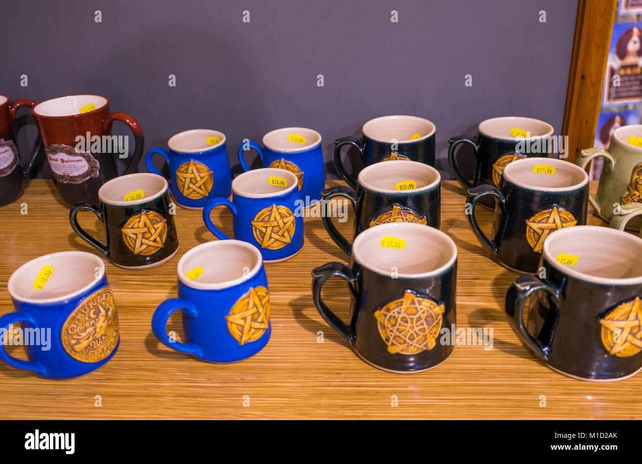 Mugs with a pentagram symbol on it in an esoteric, spiritual witchcraft shop - Stock Image