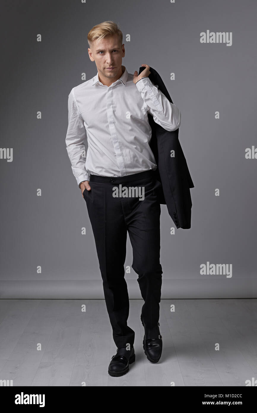 Casual businessman portrait demonstrating facial expression - Stock Image