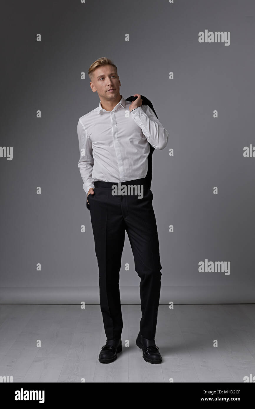 Confident businessman portrait posing relaxed - Stock Image