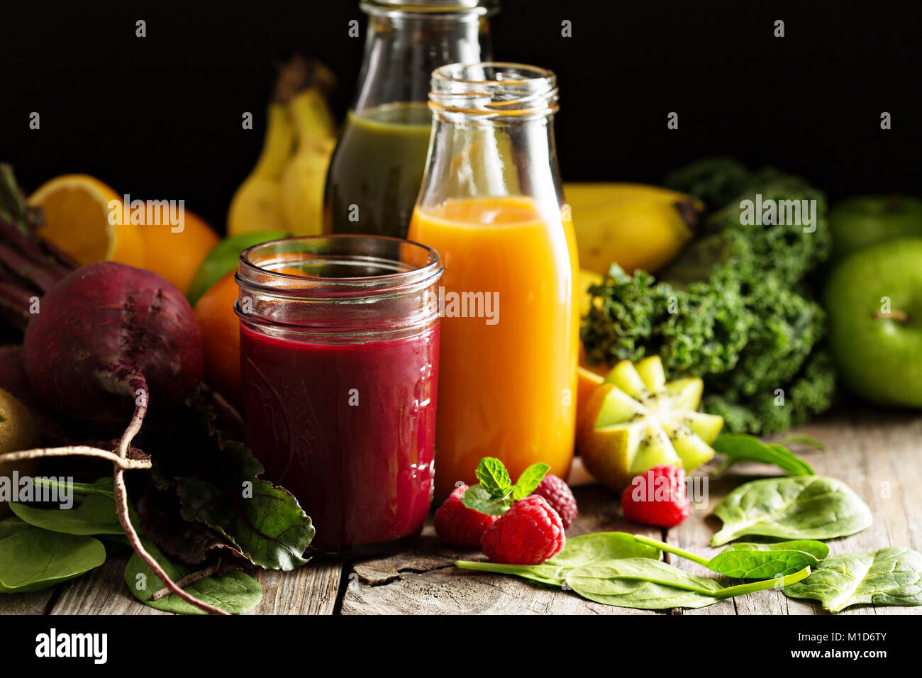 Fresh vegetable and fruit juices with beets, berries and greens - Stock Image