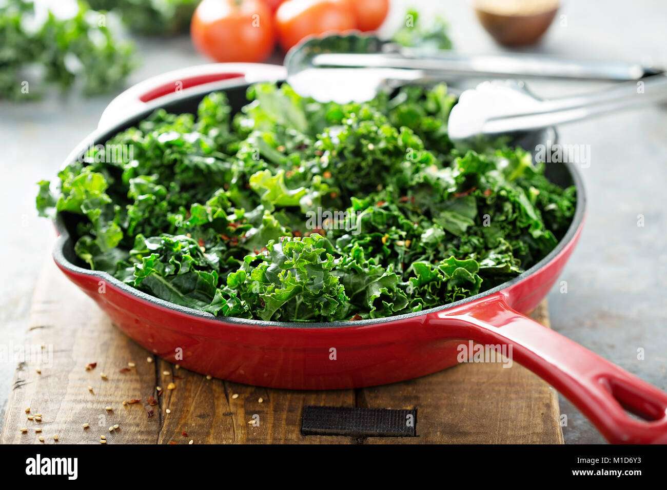 Sauteed kale with chili flakes - Stock Image