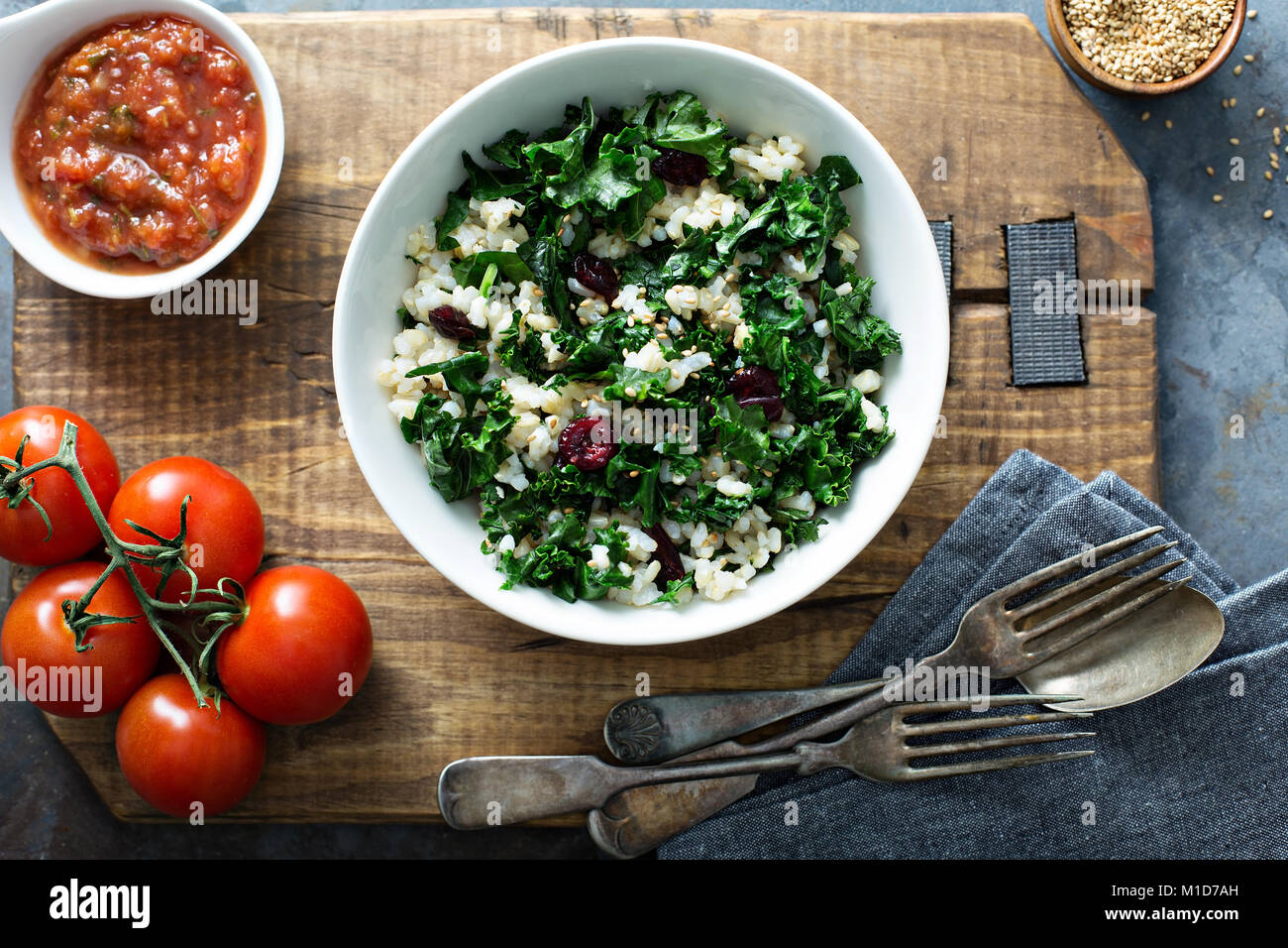 Warm kale salad with brown rice and cranberry - Stock Image