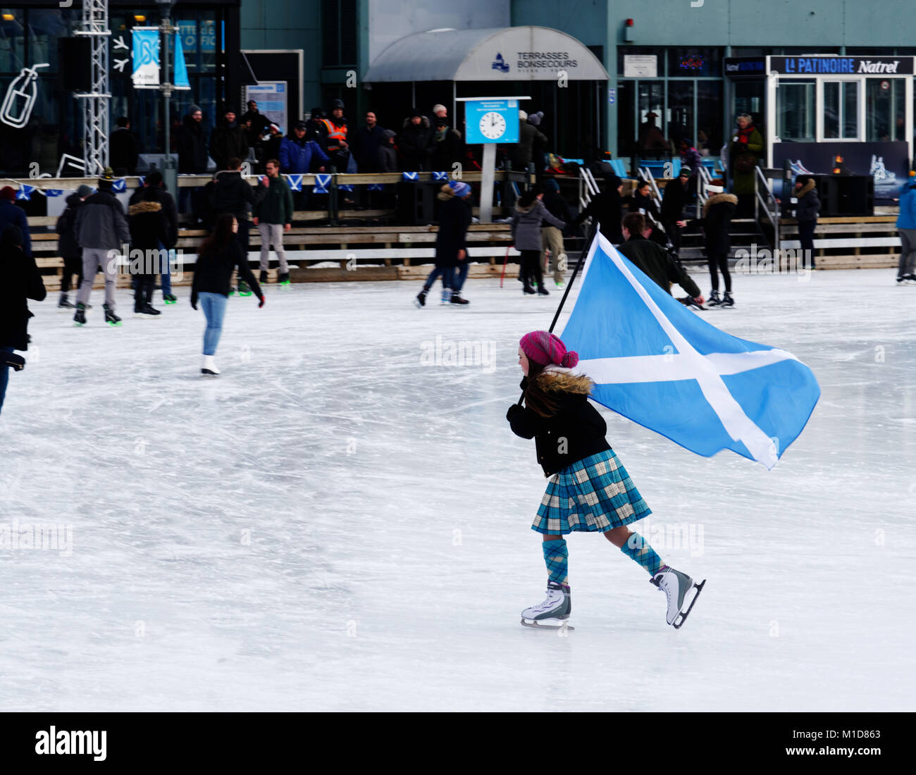 A skater in Montreal Old Port flying the Saltire, celebrating their Scottish ancestry in the annual Great Canadian - Stock Image
