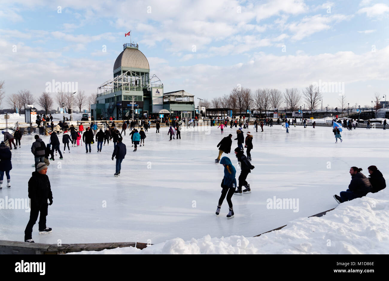 Skaters on the ice skating rink in the Old Port (Vieux Port) area of Montreal, Quebec, Canada - Stock Image