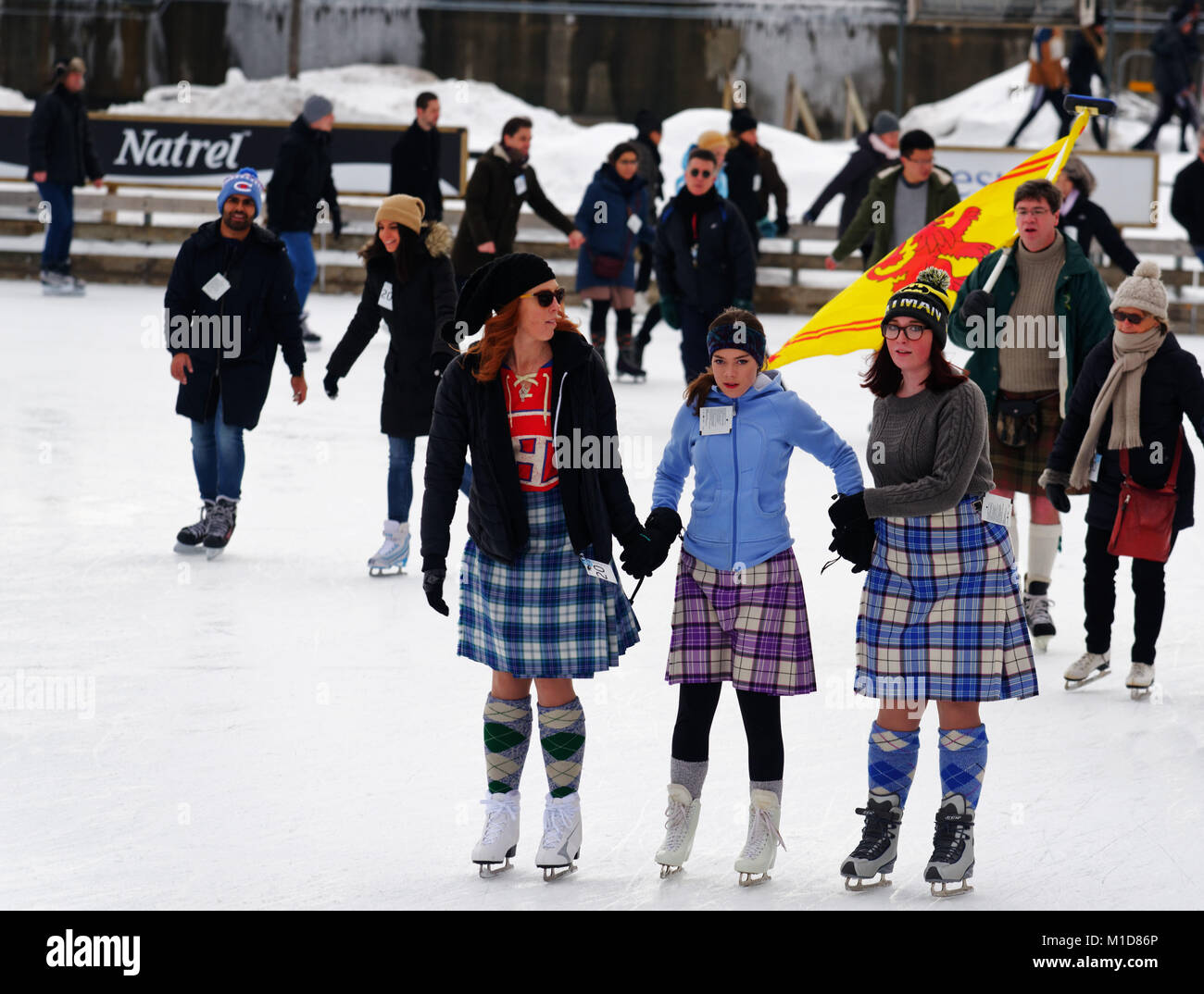 Skaters in Montreal Old Port celebrating their Scottish ancestry in the annual Great Canadian Kilt Skate - Stock Image