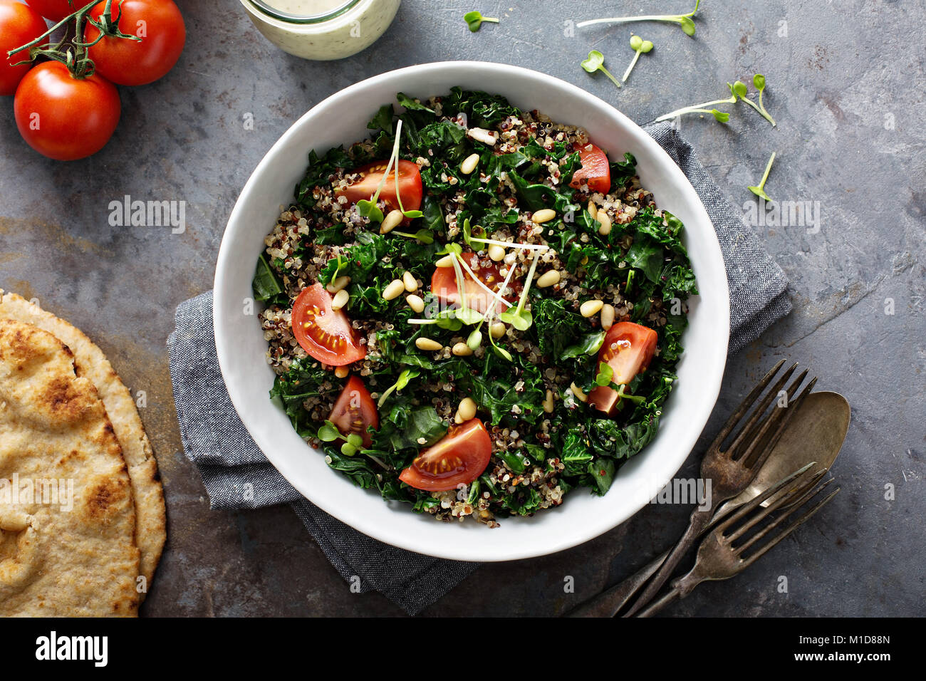 Kale and quinoa salad with tomatoes - Stock Image