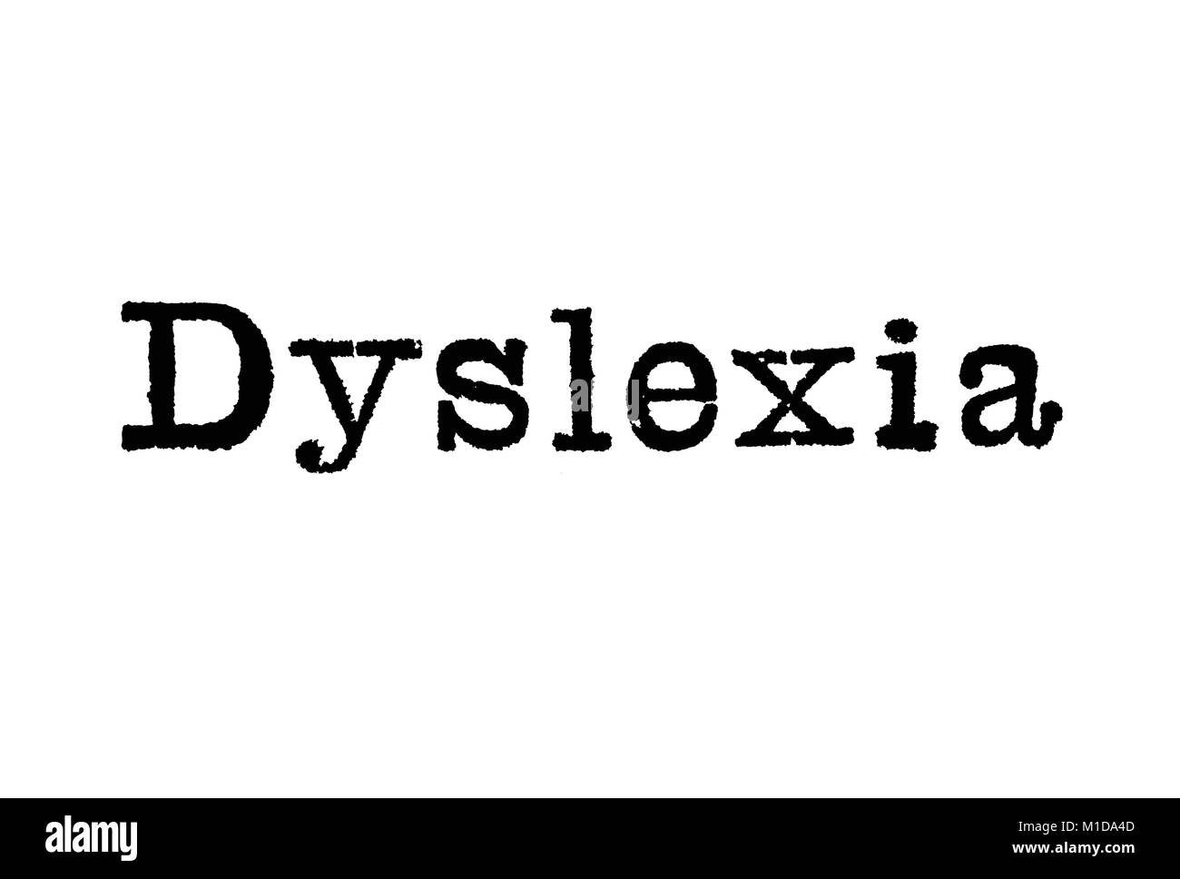 The word Dyslexia from a typewriter on a white background - Stock Image