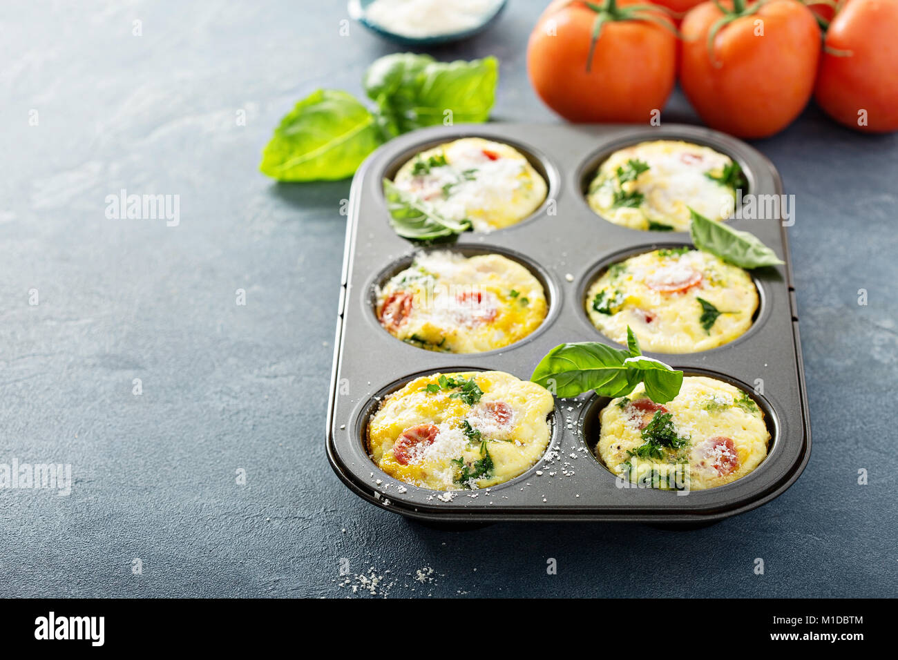 Healthy egg muffins, mini frittatas with tomatoes - Stock Image