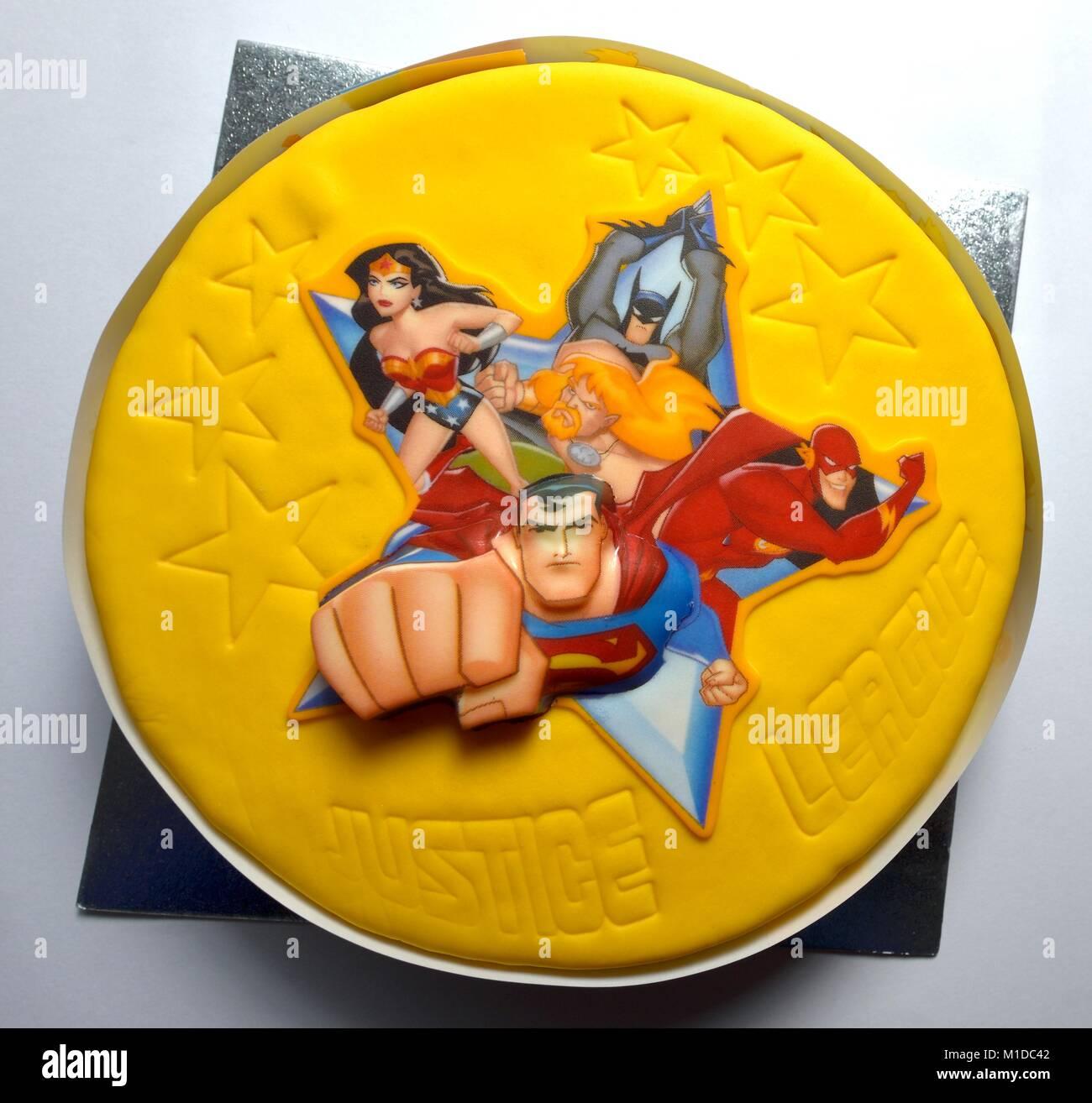Superhero birthday cake - Stock Image