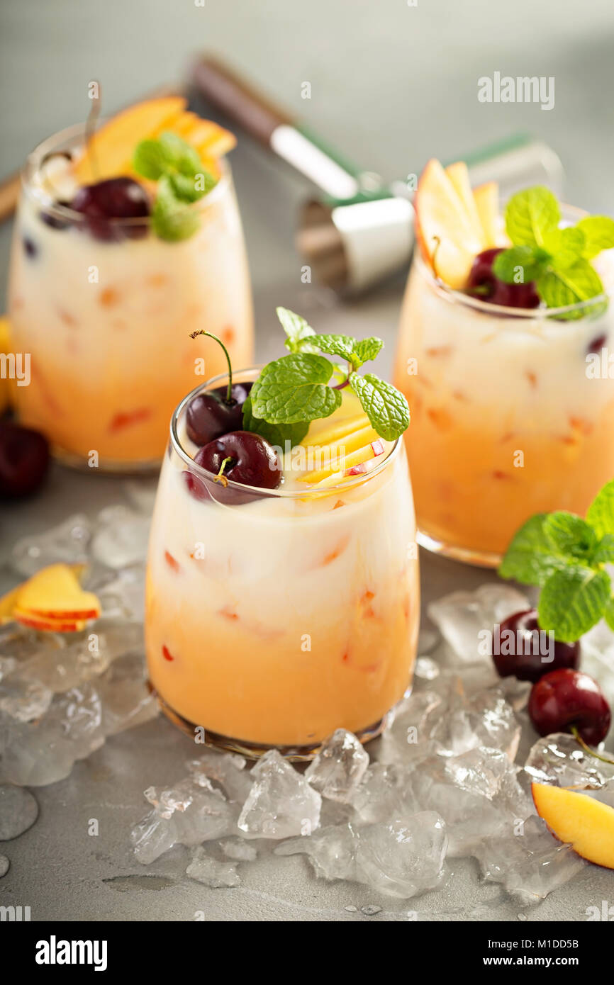 Summer cherry and peach coconut milk cocktail - Stock Image