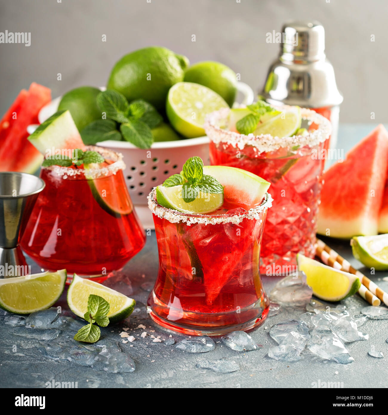 Watermelon margarita with limes - Stock Image