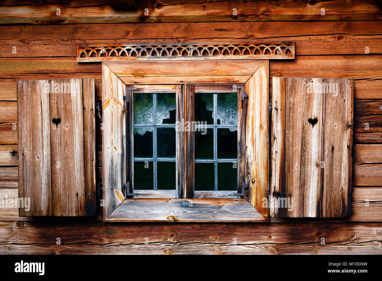 Old window shutter with heart. Rustic wooden house, simple courtains Stock Photo