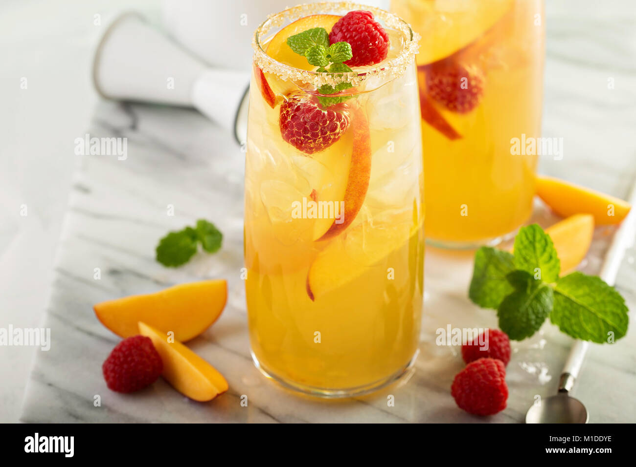Colorful refreshing cold summer drink with peaches - Stock Image