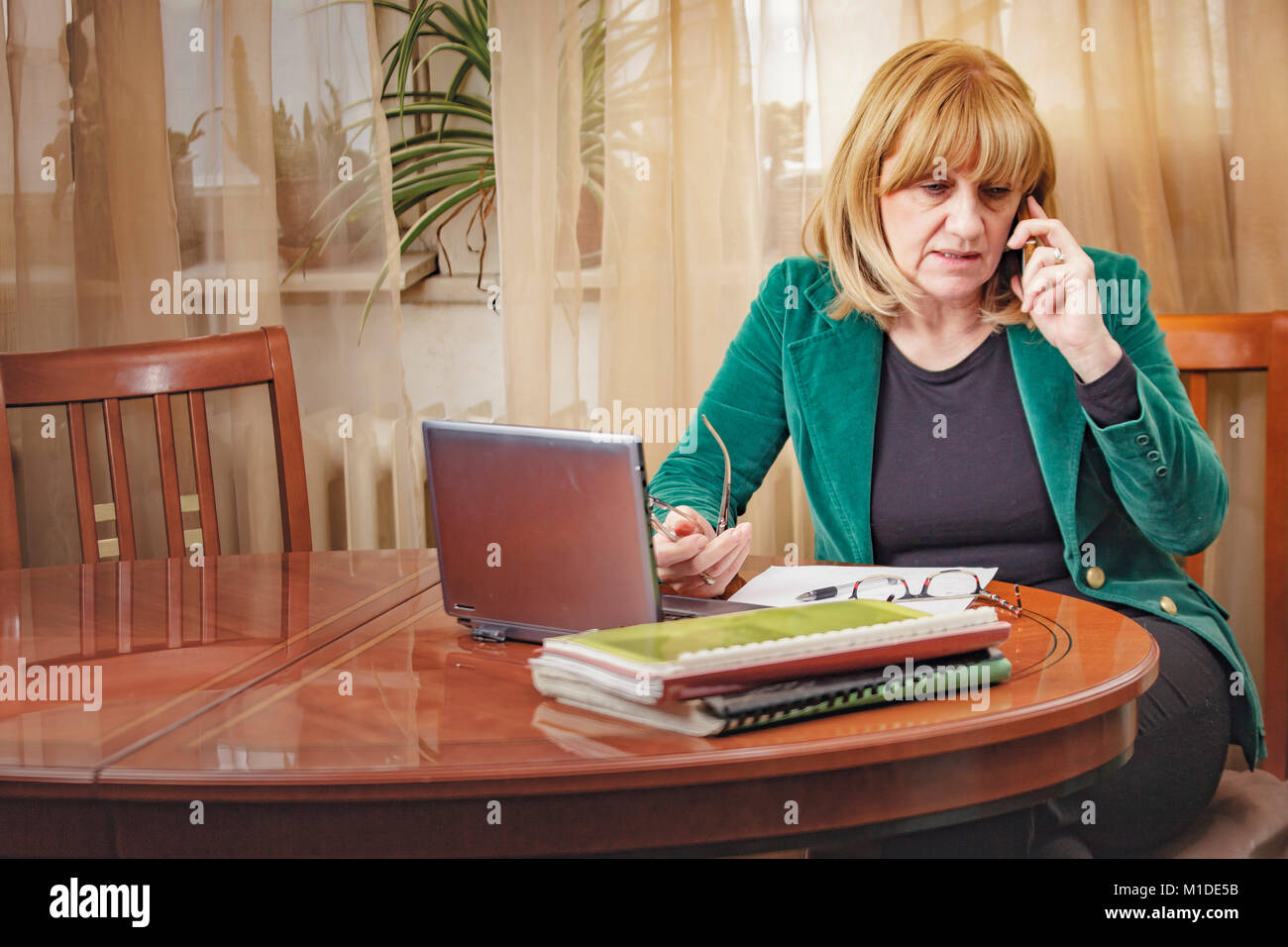 Elderly lady discussing some serious matters - Stock Image