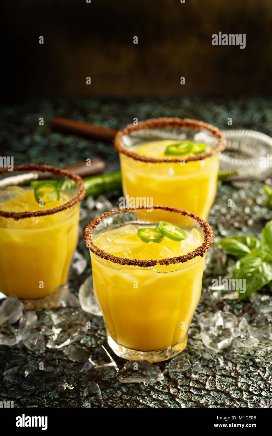 Spicy mango margaritas with hot pepper - Stock Image