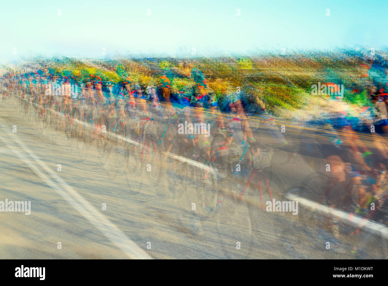 Group of cyclists on the road. The photo was created using multiple exposure technique. - Stock Image
