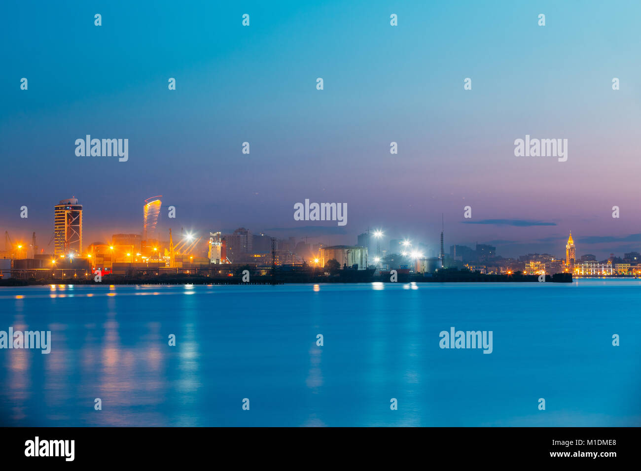 Batumi, Adjara, Georgia. Port Dock On Sunny Evening Or Night At Illuminations Lights - Stock Image