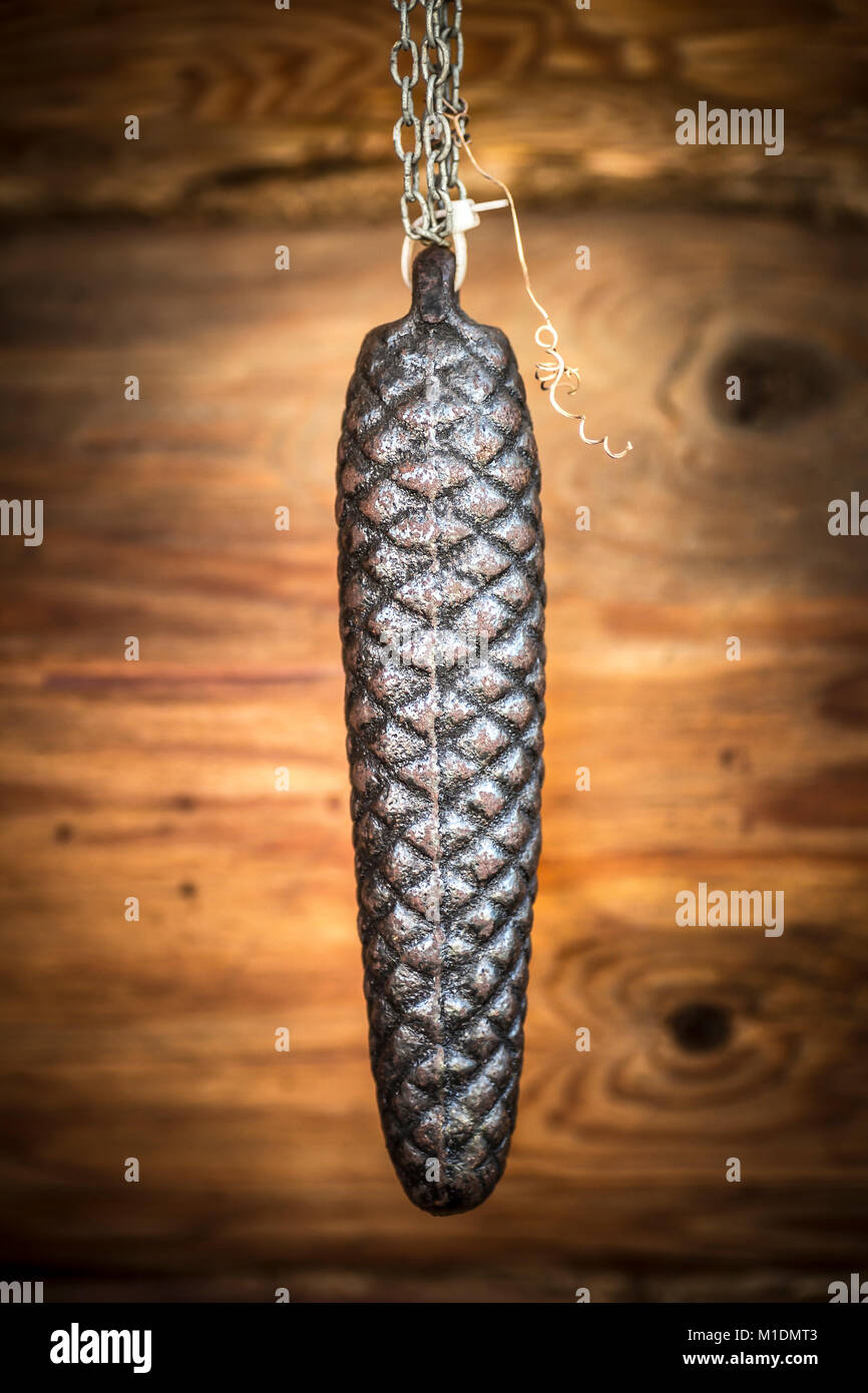 The metal weight from the old clock in the form of a cone close up. Stock Photo