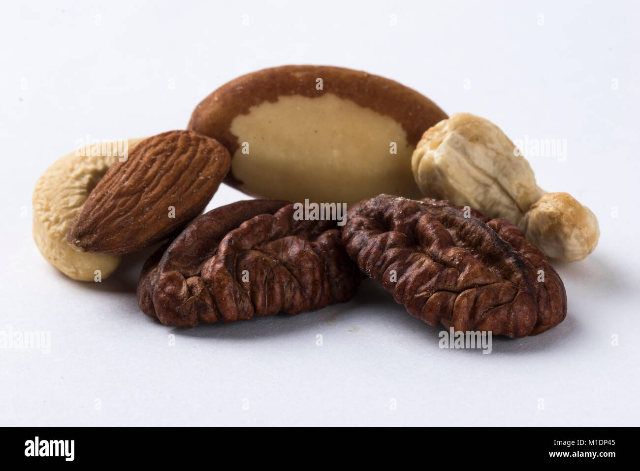 Mixed nuts isolated on a white background - Stock Image
