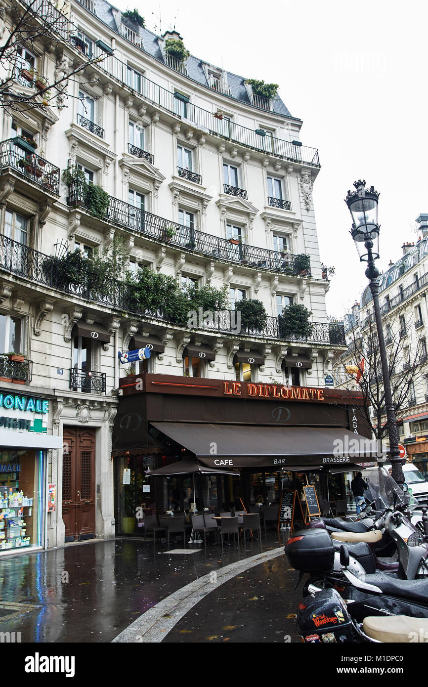 French apartment buildings and shop fronts around rochechouart in Paris - Stock Image