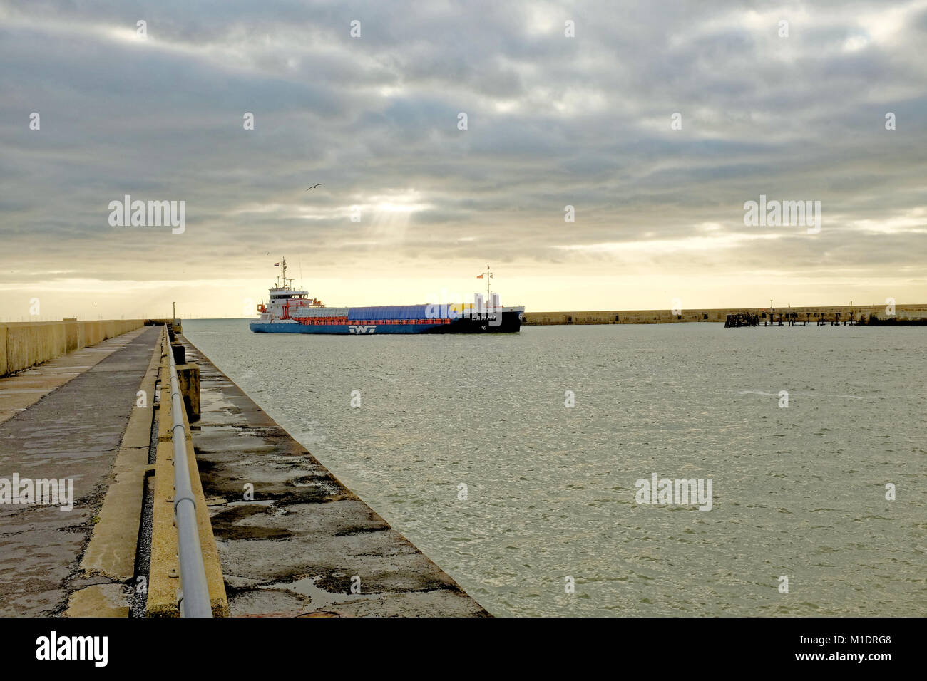 The general cargo ship Lammy enters Port Shoreham, Shoreham-by-Sea, West Sussex, England, UK. - Stock Image