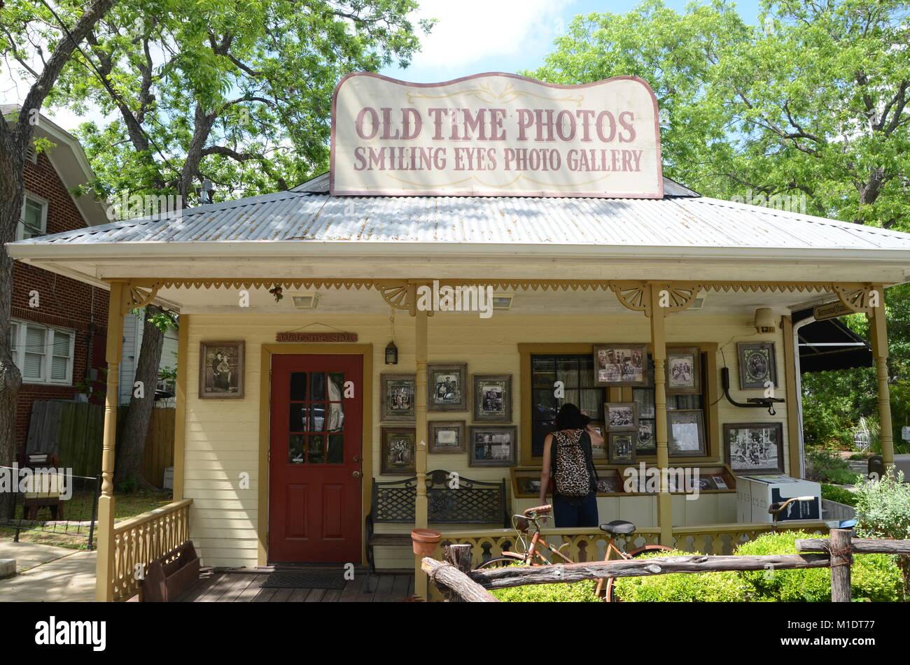 smiling eyes photo gallery, old time photos, gruene texas USA - Stock Image