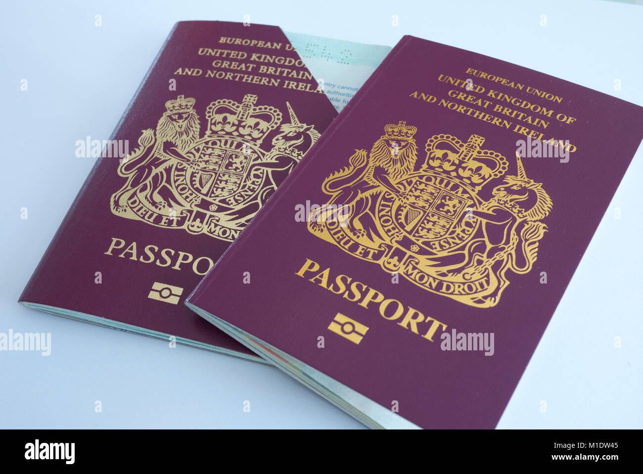 Two UK Passports, one cancelled and a renewal, UK. - Stock Image