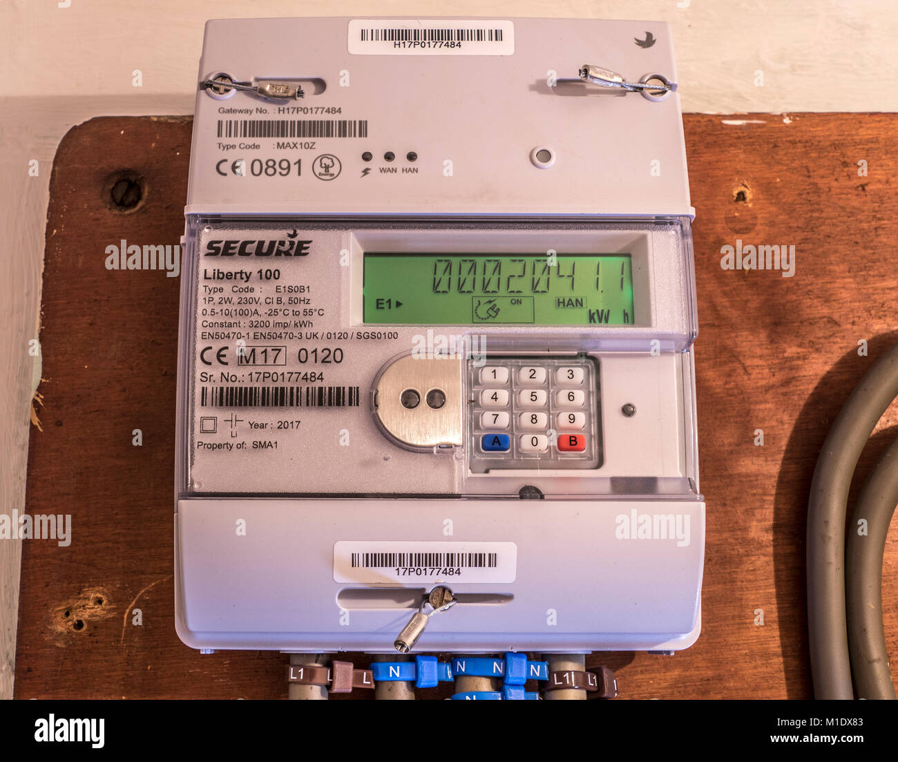 Secure Liberty 100 smart electricity meter, measuring consumption and relaying the kWh reading via the display panel. - Stock Image