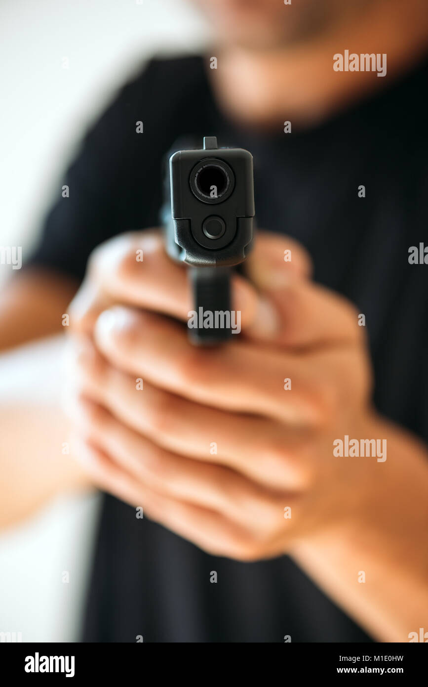 Men with handgun close up - Stock Image