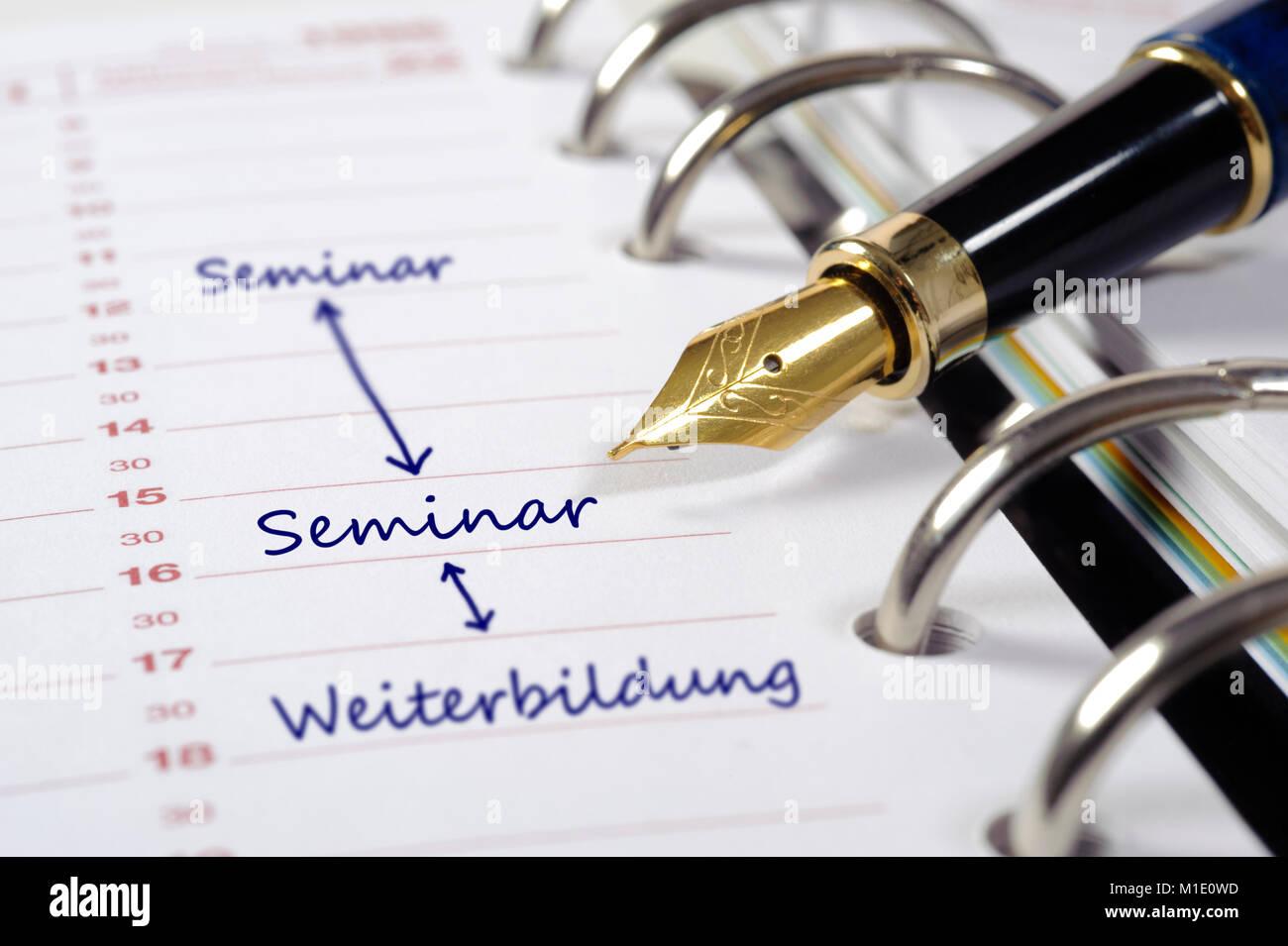 Terminkalender, mit Eintrag für Seminar und Weiterbildung Stock Photo