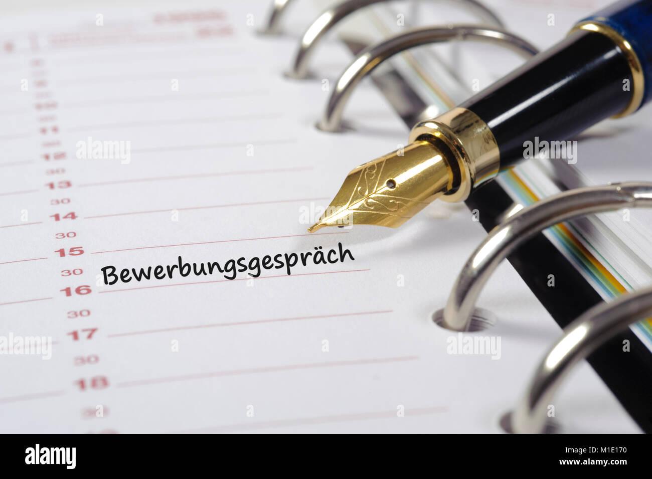Termin für Bewerbungsgespräch im Kalender Stock Photo