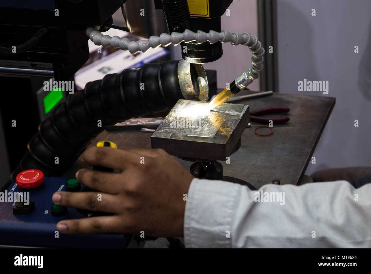 Welder operate laser welding machine - Stock Image