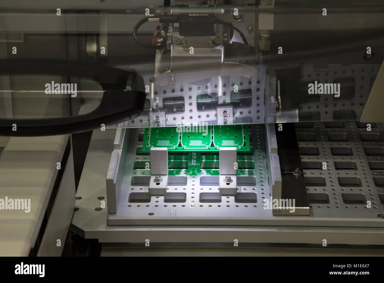 PCB loading / unloading for in-line PCB router - Stock Image