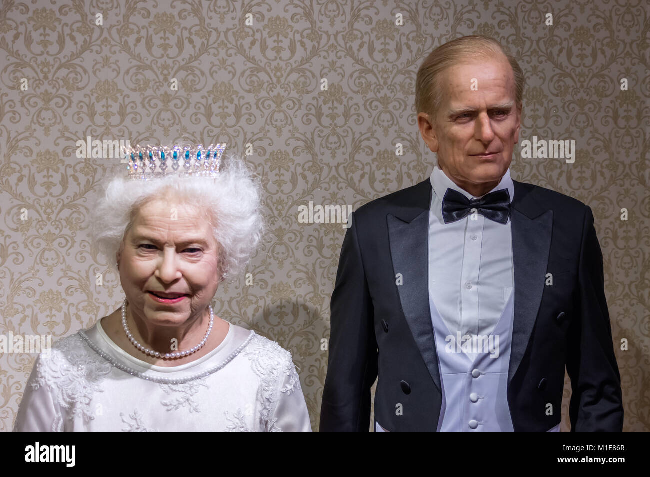 Wax statues of Queen Elizabeth II and Prince Philip at the Krakow Wax Museum - Cracow, Poland. - Stock Image