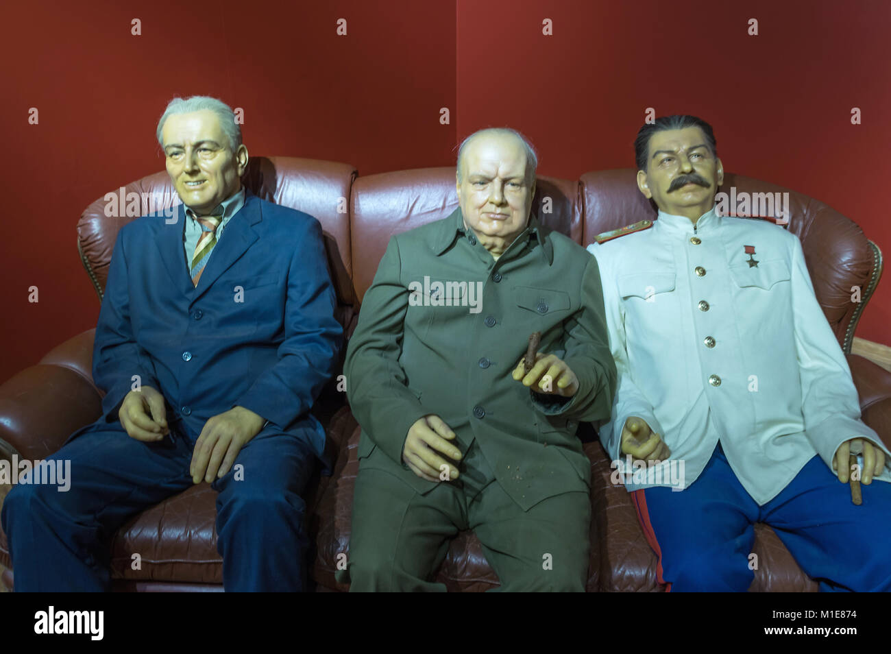 Wax statues of World War II leaders Roosevelt, Churchill and Stalin at the Krakow Wax Museum - Cracow, Poland. - Stock Image