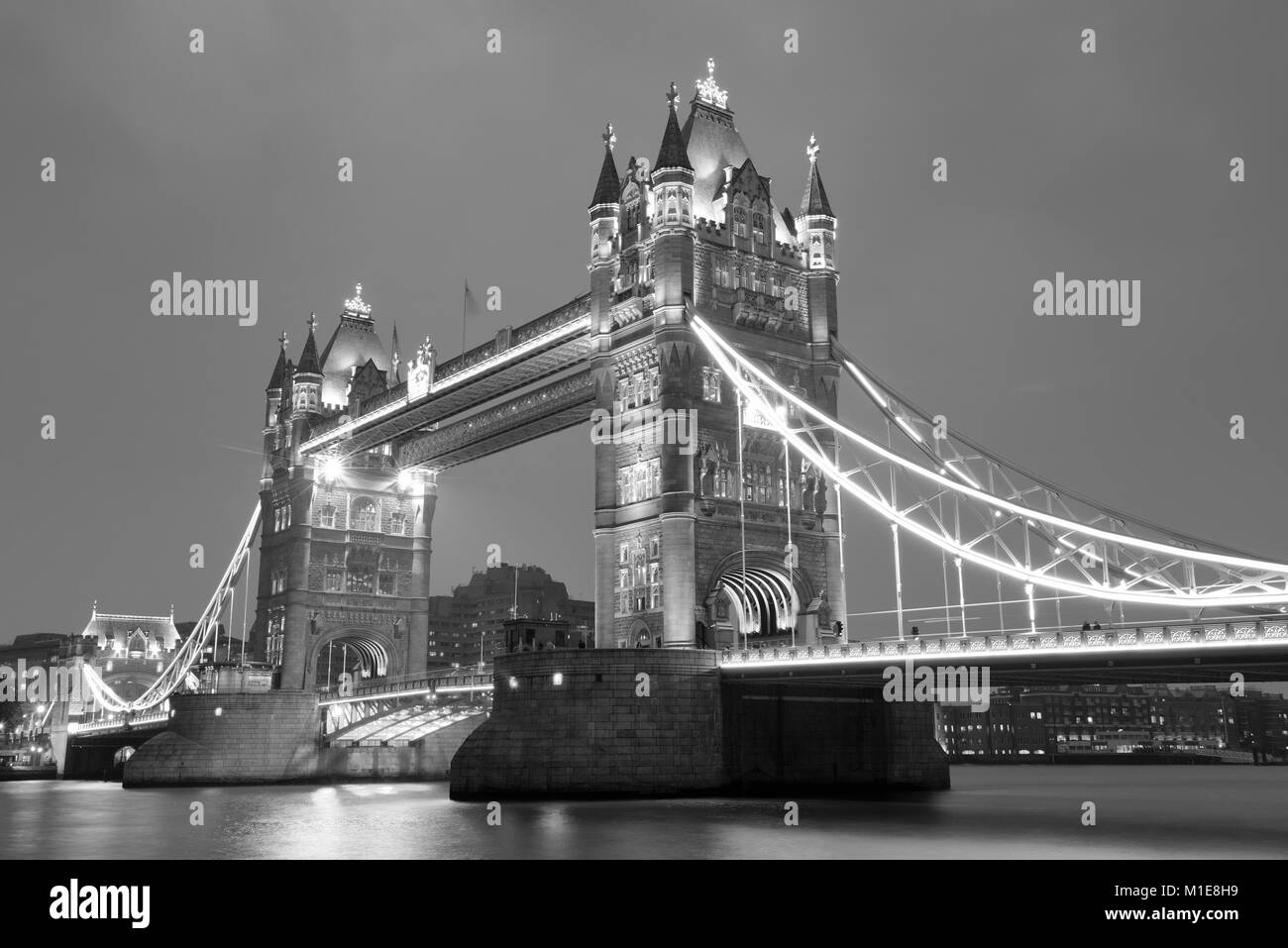 Tower Bridge in London in black and white at night. - Stock Image
