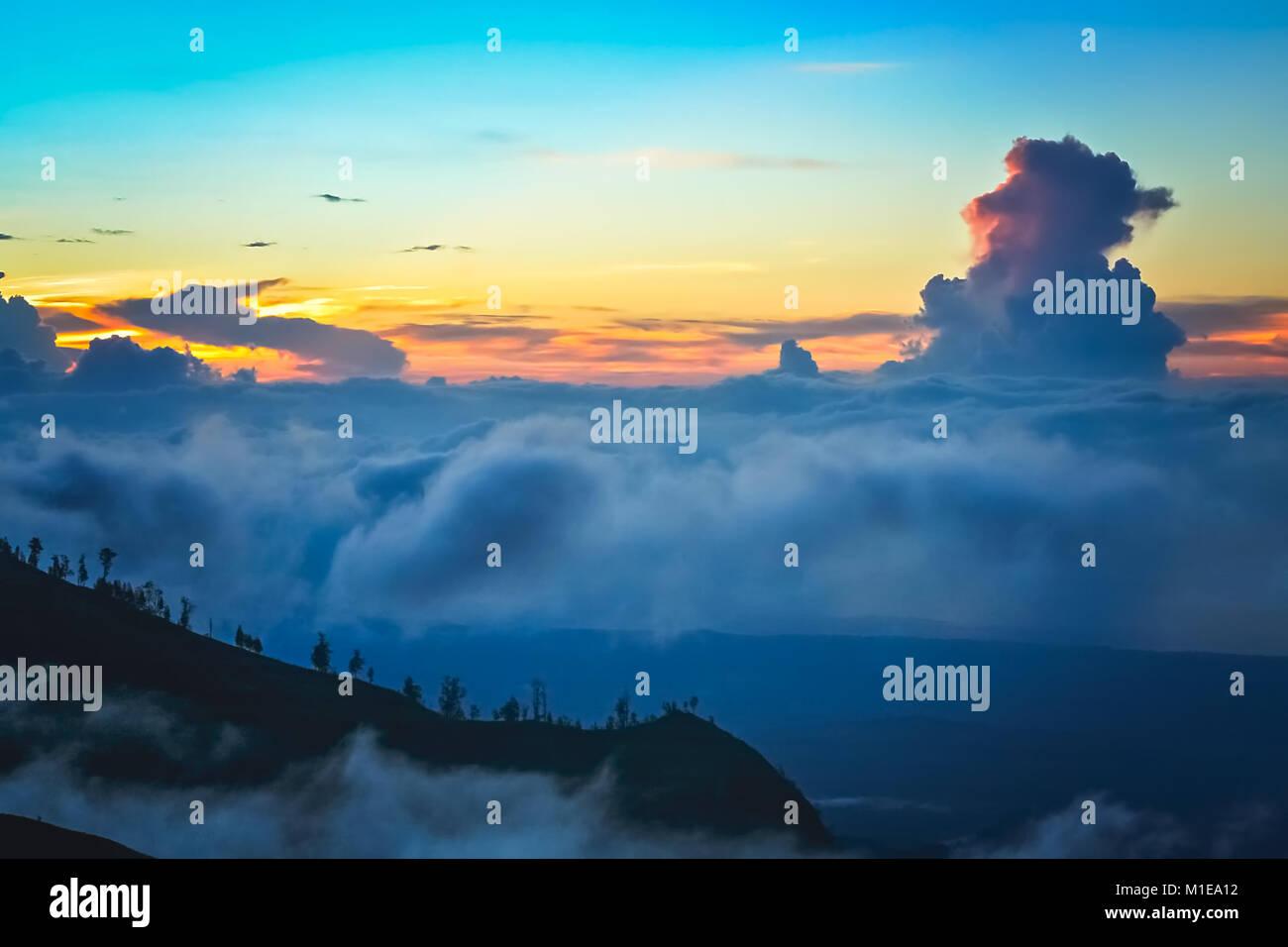 Dense clouds below the top of a ridge of Gunung Rinjani volcano in Lombok island, Indonesia Stock Photo