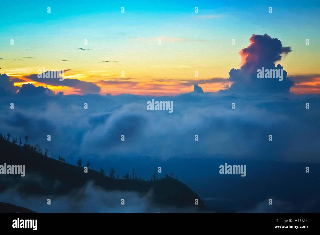 Dense clouds below the top of a ridge of Gunung Rinjani volcano in Lombok island, Indonesia - Stock Image