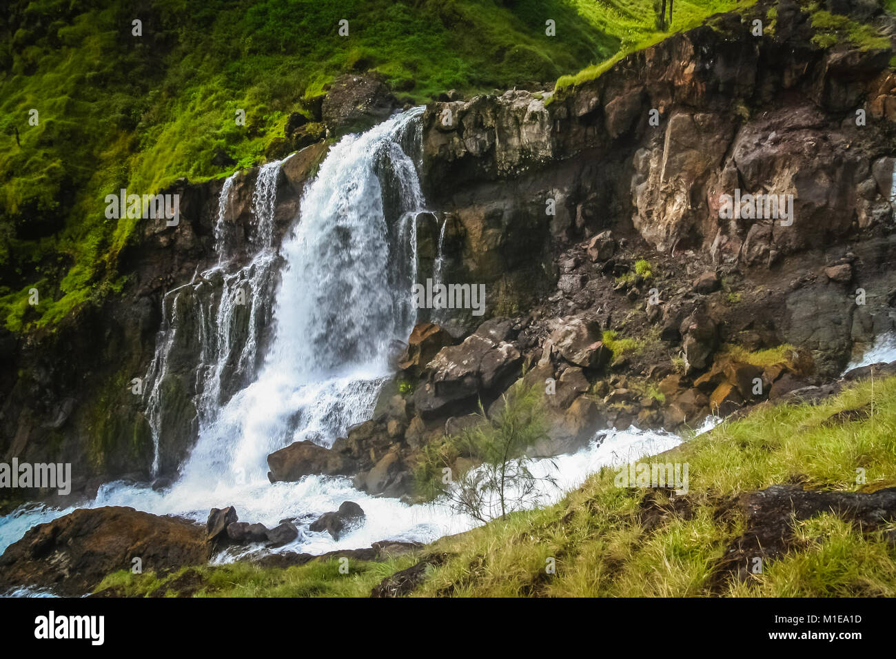 Waterfall with a water coming out of crater lake of Gunung Rinjani volcano, Lombok island, Indonesia - Stock Image