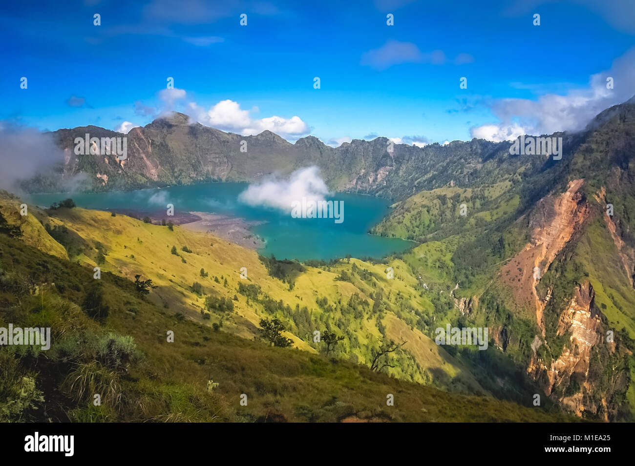 Torquise lake inside the caldera of Gunung Rinjani volcano in Lombok island,  Indonesia - Stock Image