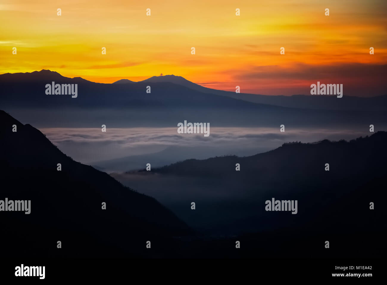 Early morning after sunrise view of the spectacular Gunung Bromo and Sumeru volcanoes in Java, Indonesia - Stock Image