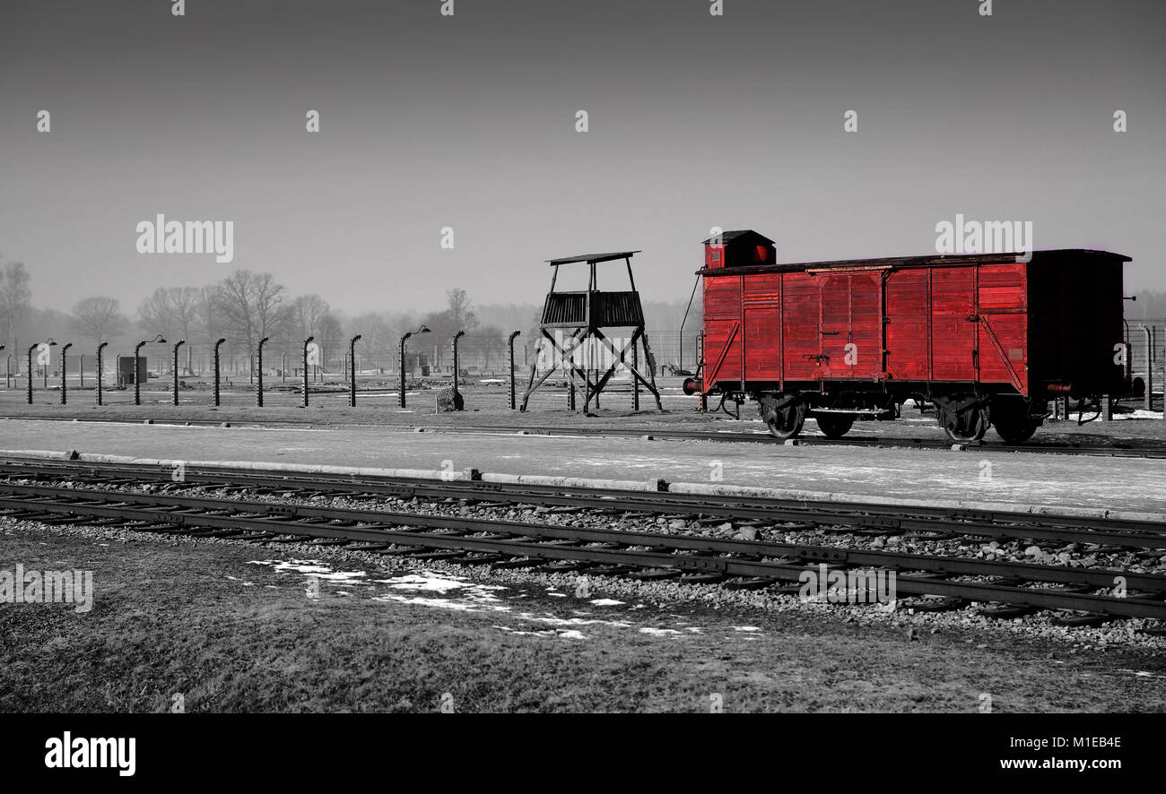 Black and white with one colour blood red picked out of railway carriage at judenrampe platform in auschwitz ii birkenau holocaust museum