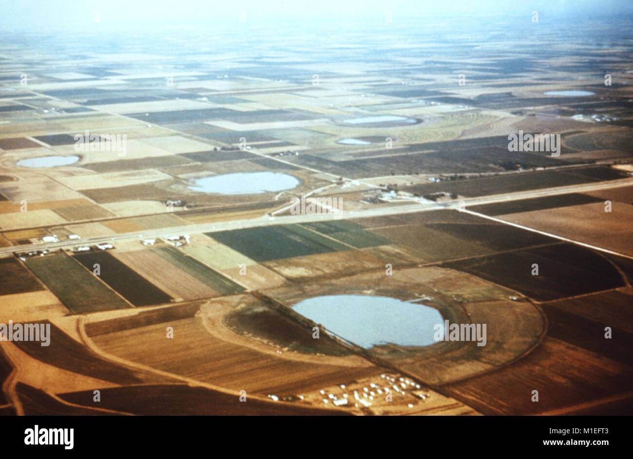 Areal photograph of playa lakes full of stagnant water with fields around them, in Texas, a site relevant to the Stock Photo